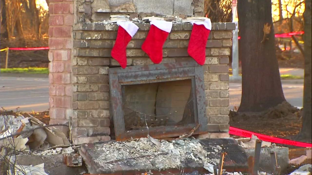 Stockings hang on a chimney in Coffey Park, Santa Rosa, Calif. showing the spirit of its former residents, forced out by the North Bay fires on Tuesday, Dec. 12, 2017.