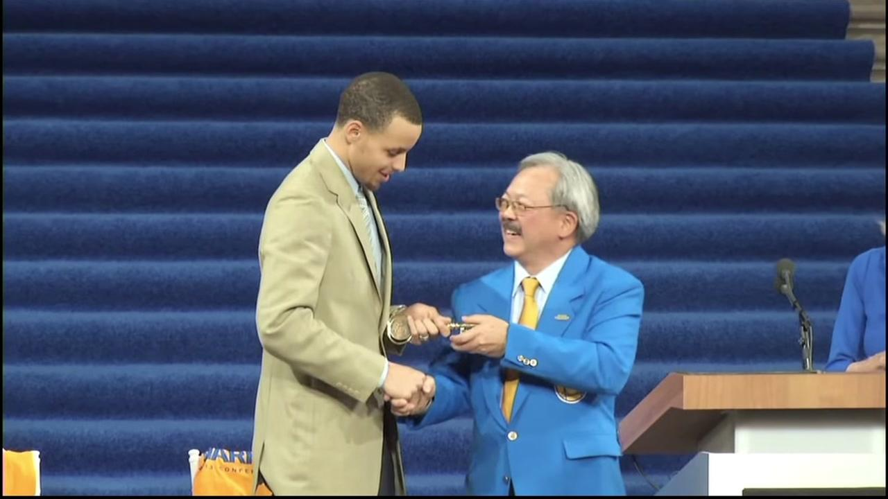 San Francisco Mayor Ed Lee gives Golden State Warriors star Stephen Curry the key to the city in this undated image.