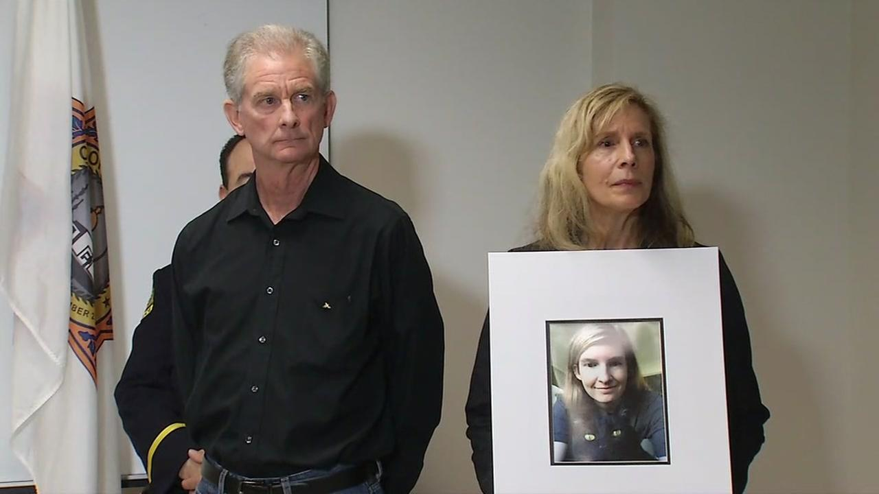 Mike and Karen Flynn are seen holding a photo of their daughter Carly, who was killed in a hit-and-run crash in San Bruno, Calif.