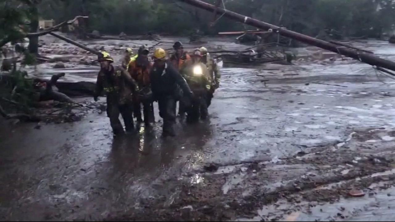 Rescuers work to help stranded people in Montecito, Calif. during mudslides and flooding in Jan. 2017.
