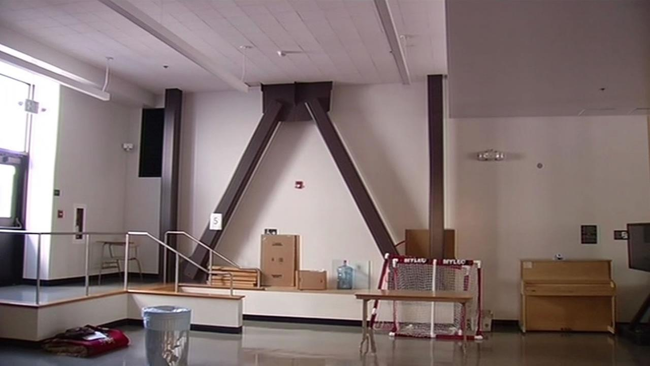 Cross bracing beams are used to help seismically reinforce school buildings.