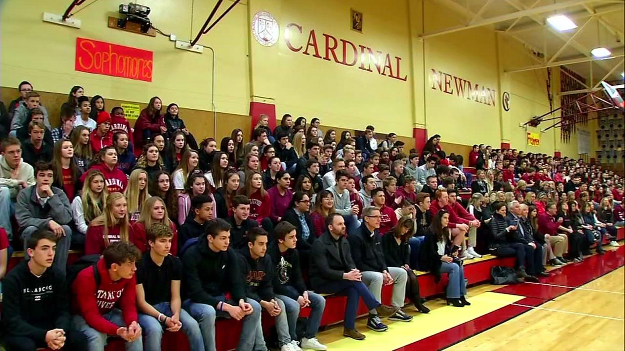 Students, faculty and parents are seen at Cardinal Newman High School in Santa Rosa, Calif. on Monday, Jan. 22, 2018.