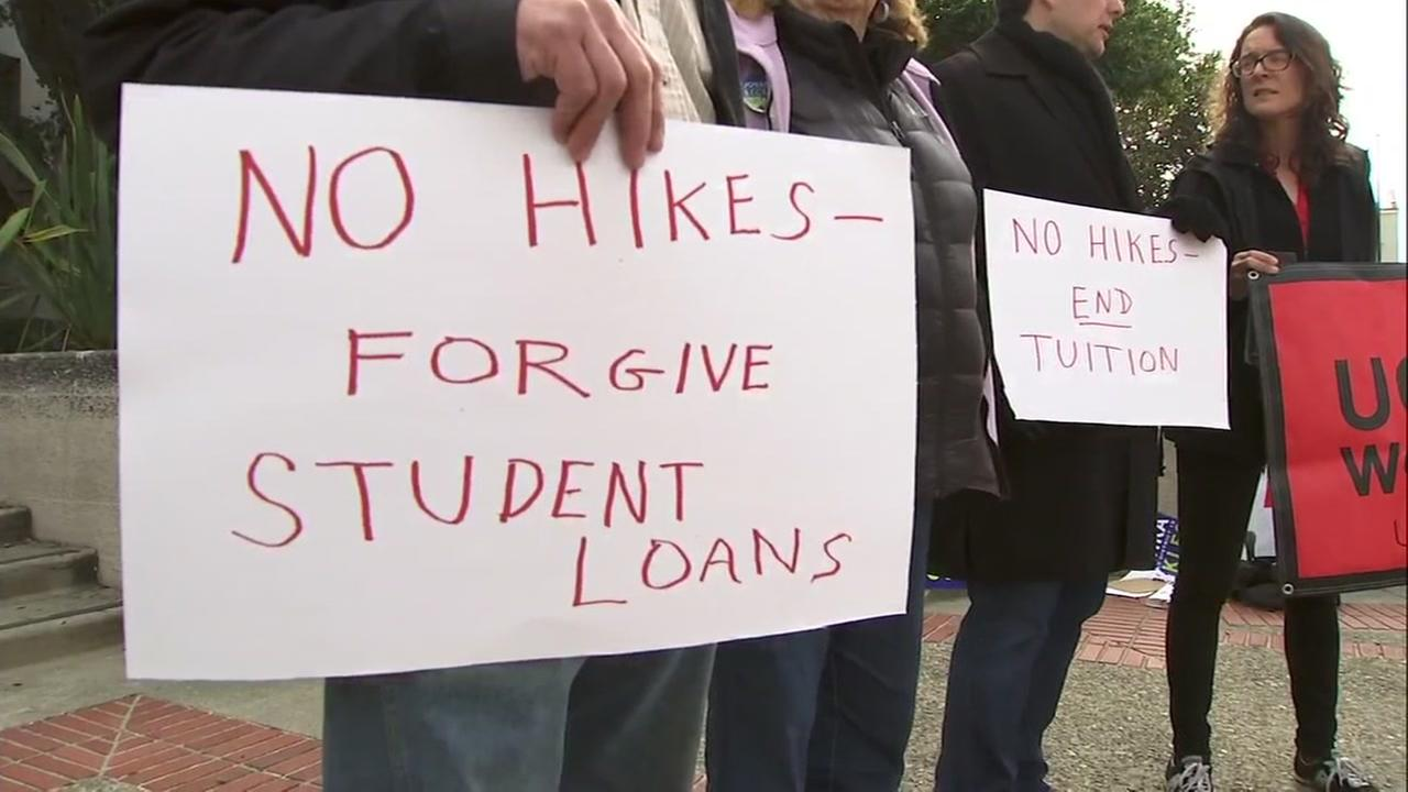 A sign opposed to UC tuition hikes is held up in this photo taken on Wednesday, Jan. 24, 2018 in Berkeley, Calif.
