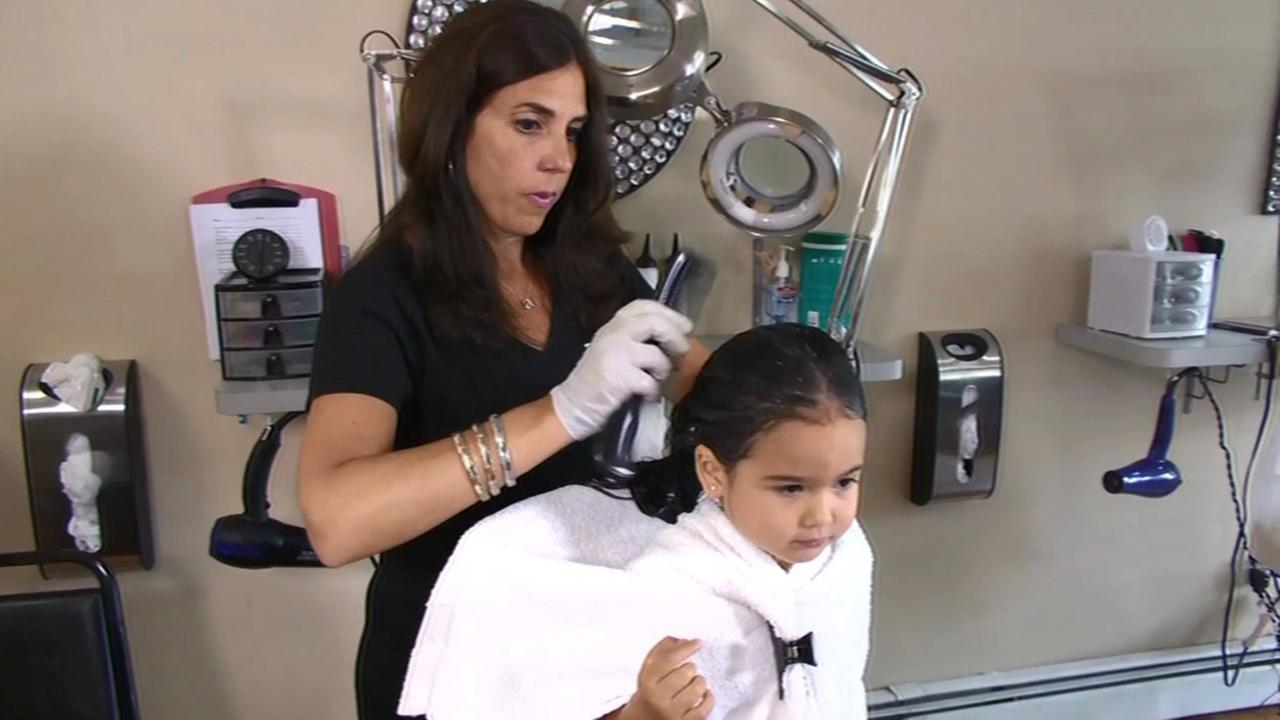 Child getting hair cut.
