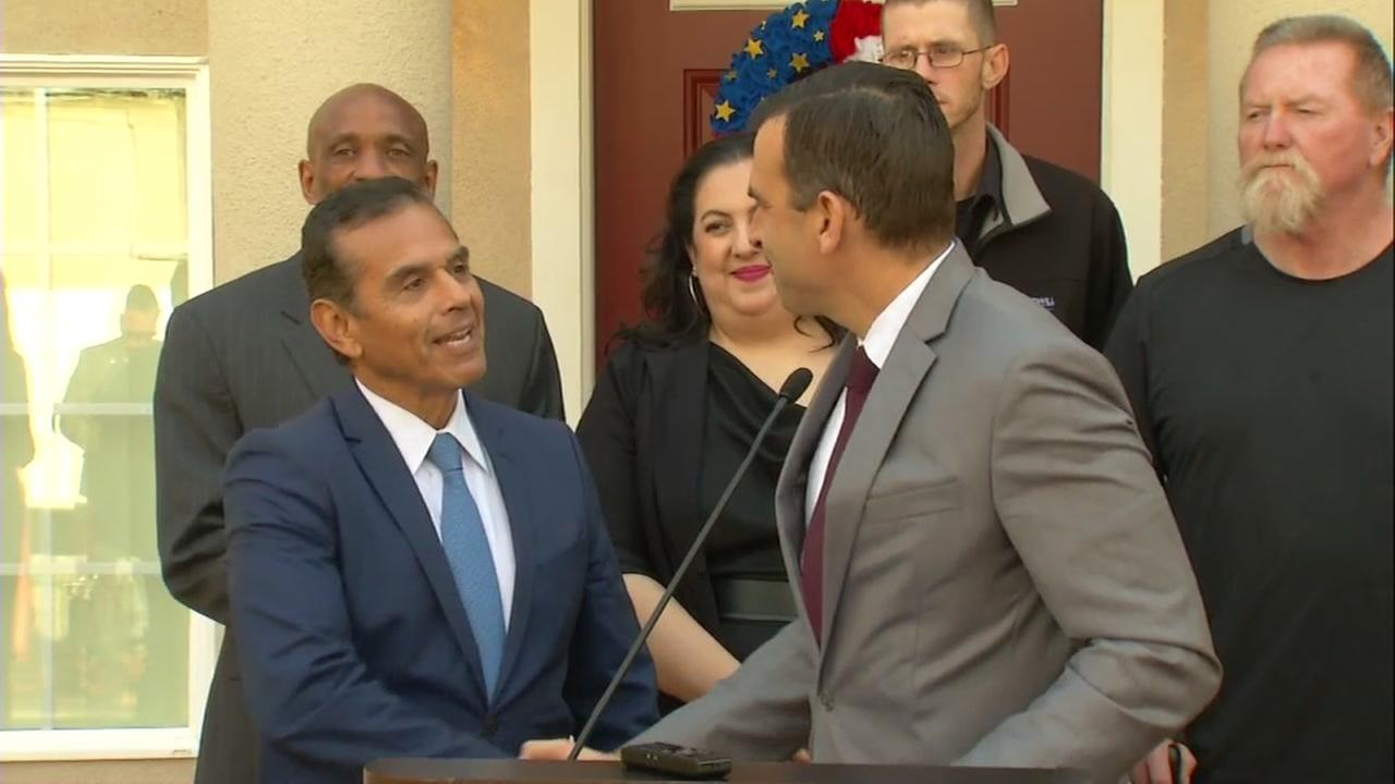 San Jose Mayor Sam Liccardo is seen shaking hands with former Los Angeles Mayor Anthony Villaraigosa in San Jose, Calif. on Wednesday, Jan. 31, 2018.