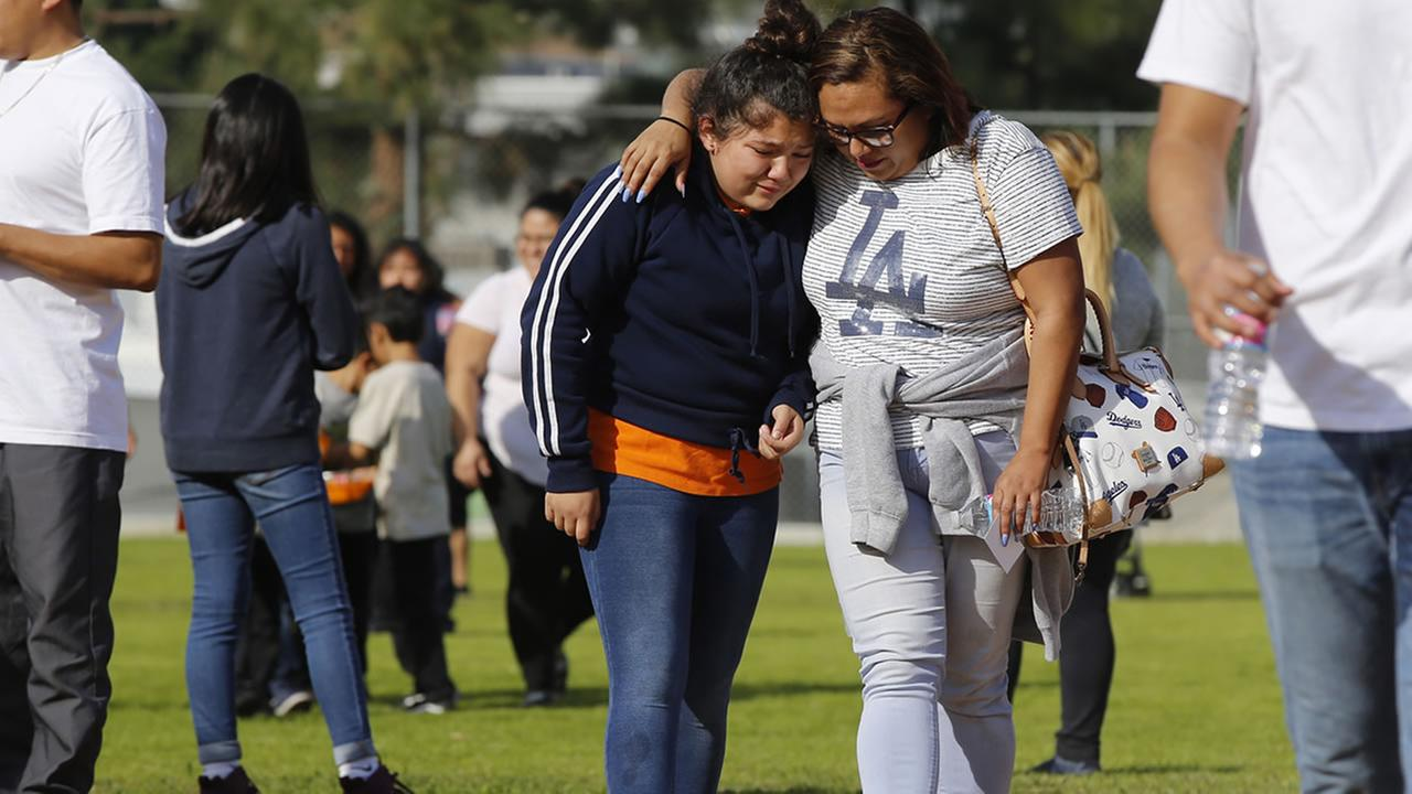 Parents reunite with their children at the Salvador B. Castro Middle School near downtown Los Angeles Thursday, Feb. 1, 2018.