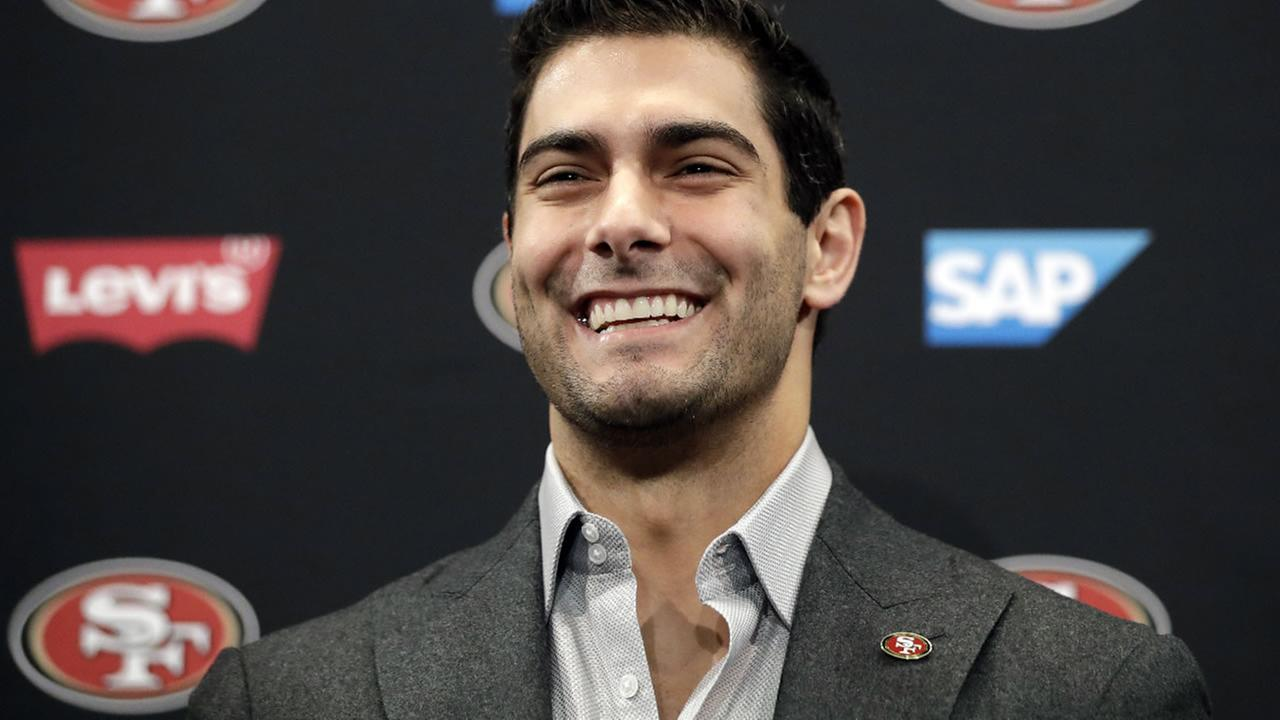 San Francisco 49ers quarterback Jimmy Garoppolo smiles during an NFL football press conference Friday, Feb. 9, 2018, in Santa Clara, Calif. (AP Photo/Marcio Jose Sanchez)