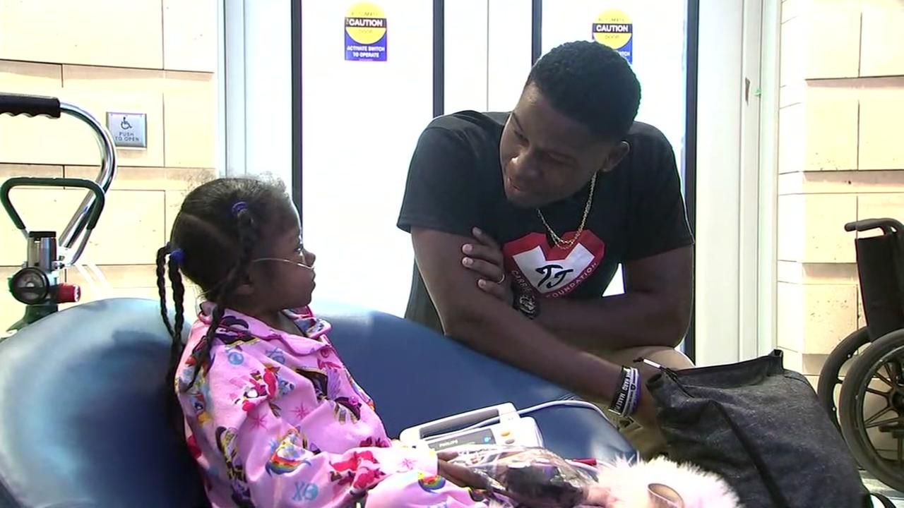 Oakland Raiders player TJ Carrie visits with a patient at Lucille Packard Childrens Hospital in Palo Alto, Calif. on Wednesday, Feb. 14, 2018.
