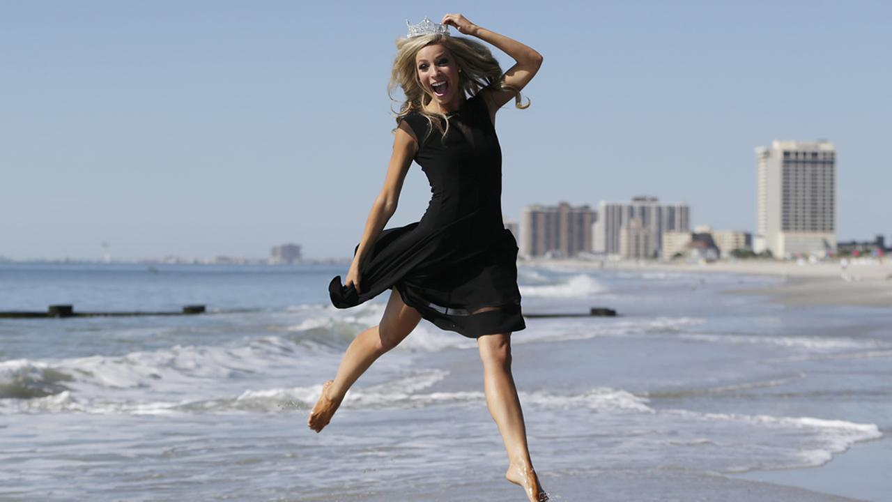 Miss America 2015 Kira Kazantsev of New York, poses for photographers during the traditional toe dip in the Atlantic Ocean the morning after she was crowned, Monday, Sept. 15, 2014, in Atlantic City, N.J. (AP Photo/Julio Cortez)