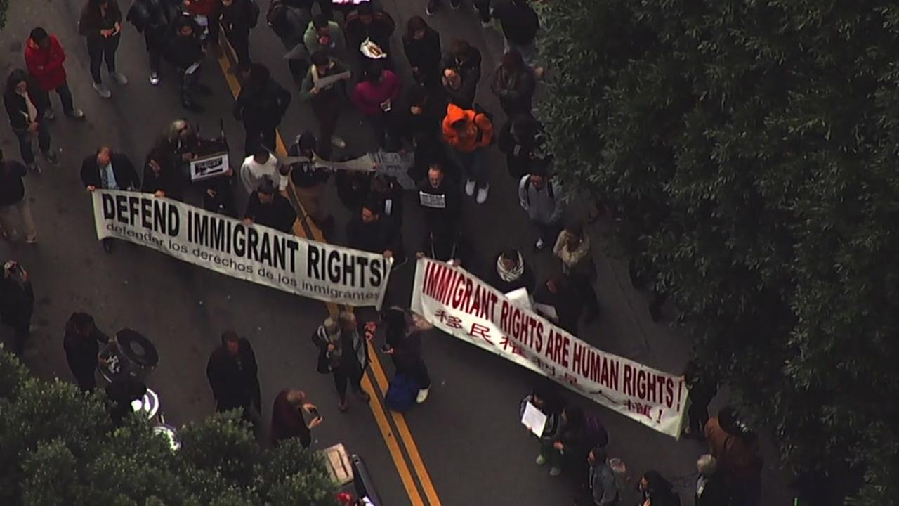 Protesters are seen outside a Immigration and Customs Enforcement building in San Francisco on Wednesday, Feb. 28, 2018.