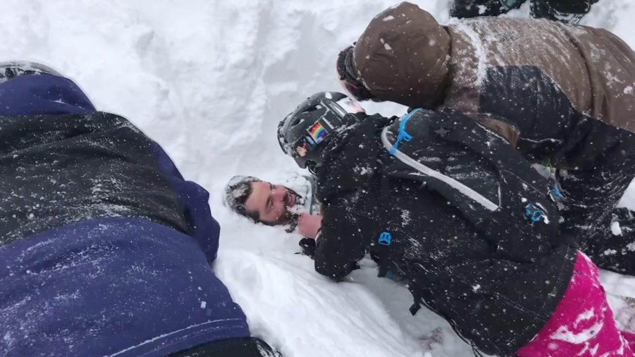 A man is seen being dug out from an avalanche near Lake Tahoe, Calif. on Friday, March 2, 2018.