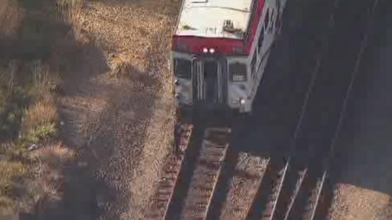 Officials are seen investigating after a fatal Caltrain accident occurred on tracks near the 22nd Street station in San Francisco on Monday, March 5, 2018.