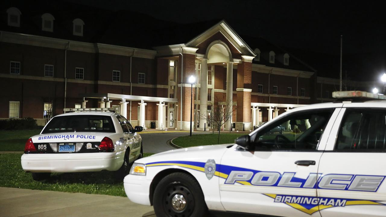 Huffman High School is seen behind Birmingham Police cars after at a shooting Wednesday, March 7, 2018, in Birmingham, Ala.