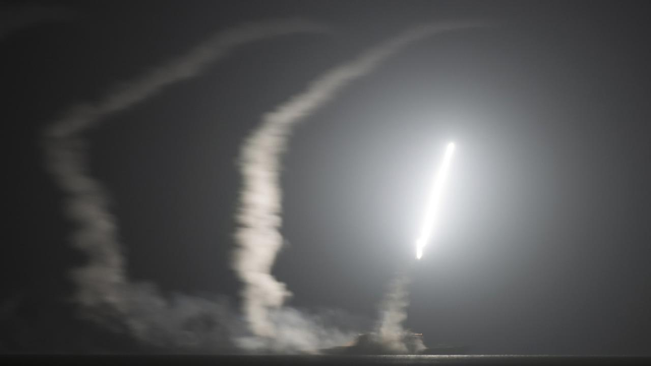 A guided-missile cruiser USS Philippine Sea launches a Tomahawk cruise missile at Islamic State group positions in Syria on Sept. 23, 2014. (AP Photo/Eric Garst, U.S. Navy)
