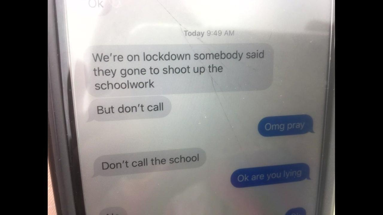 A text message is seen after a graffiti threat was found at a high school in San Leandro, Calif. on Wednesday, March 14, 2018.