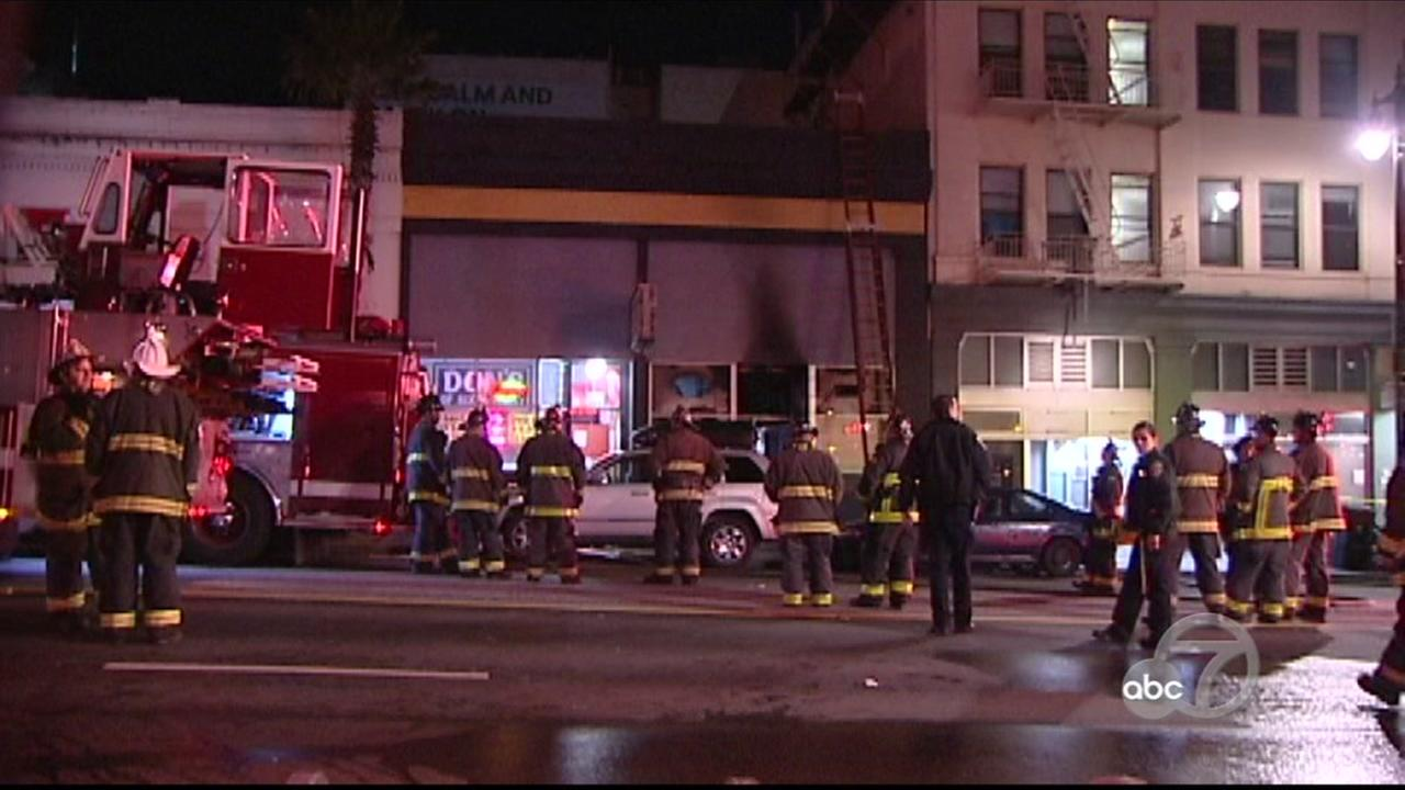 Firefighters are seen outside an adult video and bookstore after a deadly fire in San Francisco on Saturday, March 17, 2018.