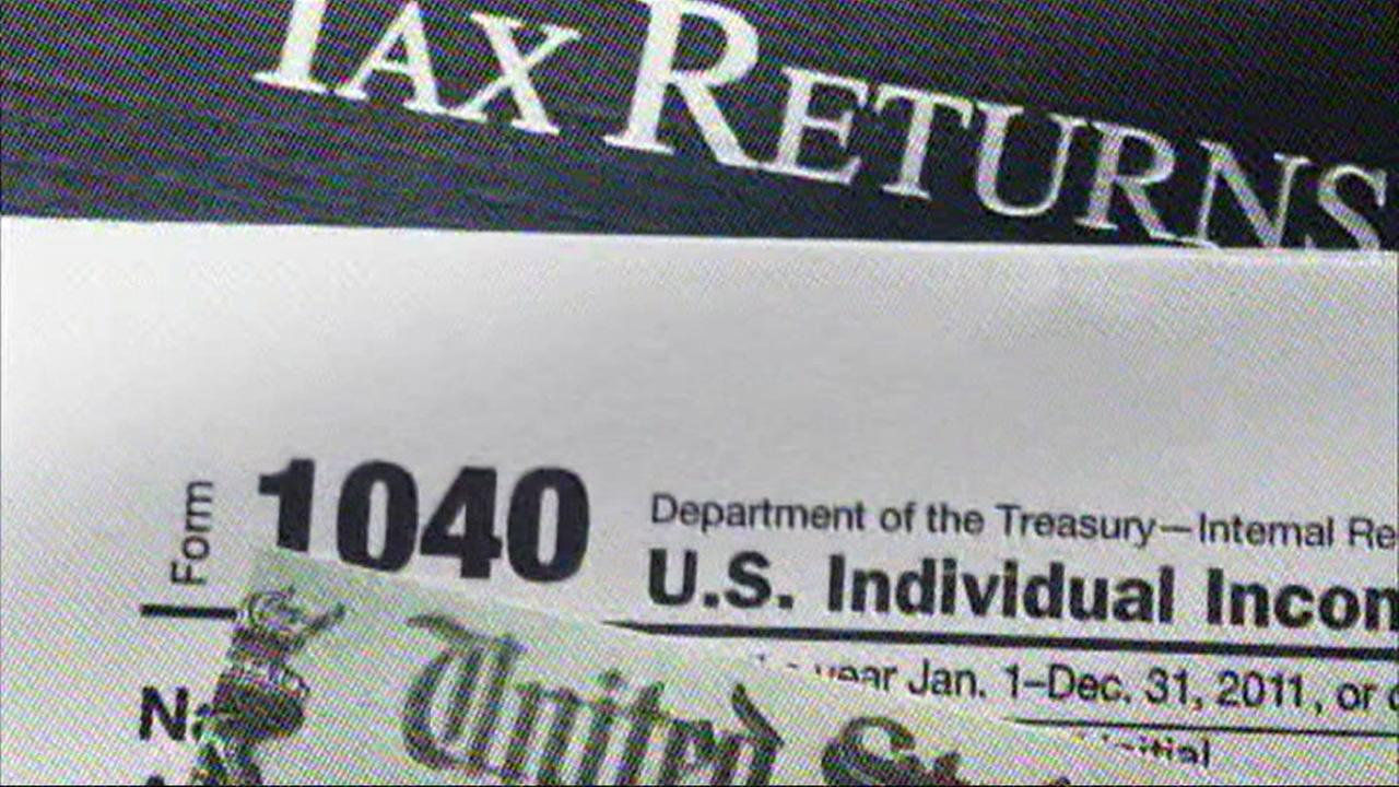 Tax forms are seen in this undated image.