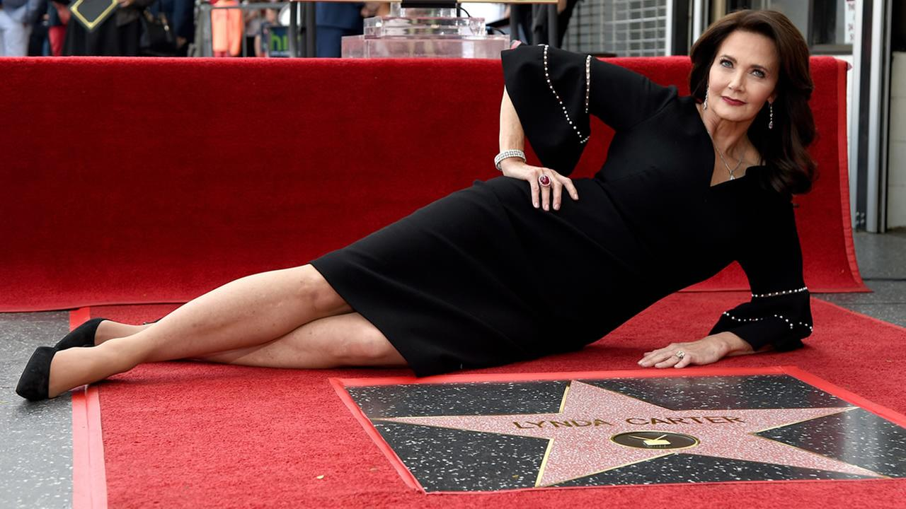 Lynda Carter poses with her star on the Hollywood Walk of Fame following a ceremony on Tuesday, April 3, 2018, in Los Angeles. (Photo by Chris Pizzello/Invision/AP)