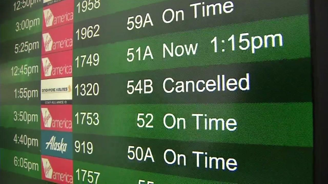 This departures board is pictured at San Francisco International Airport on Friday, April 6, 2018.