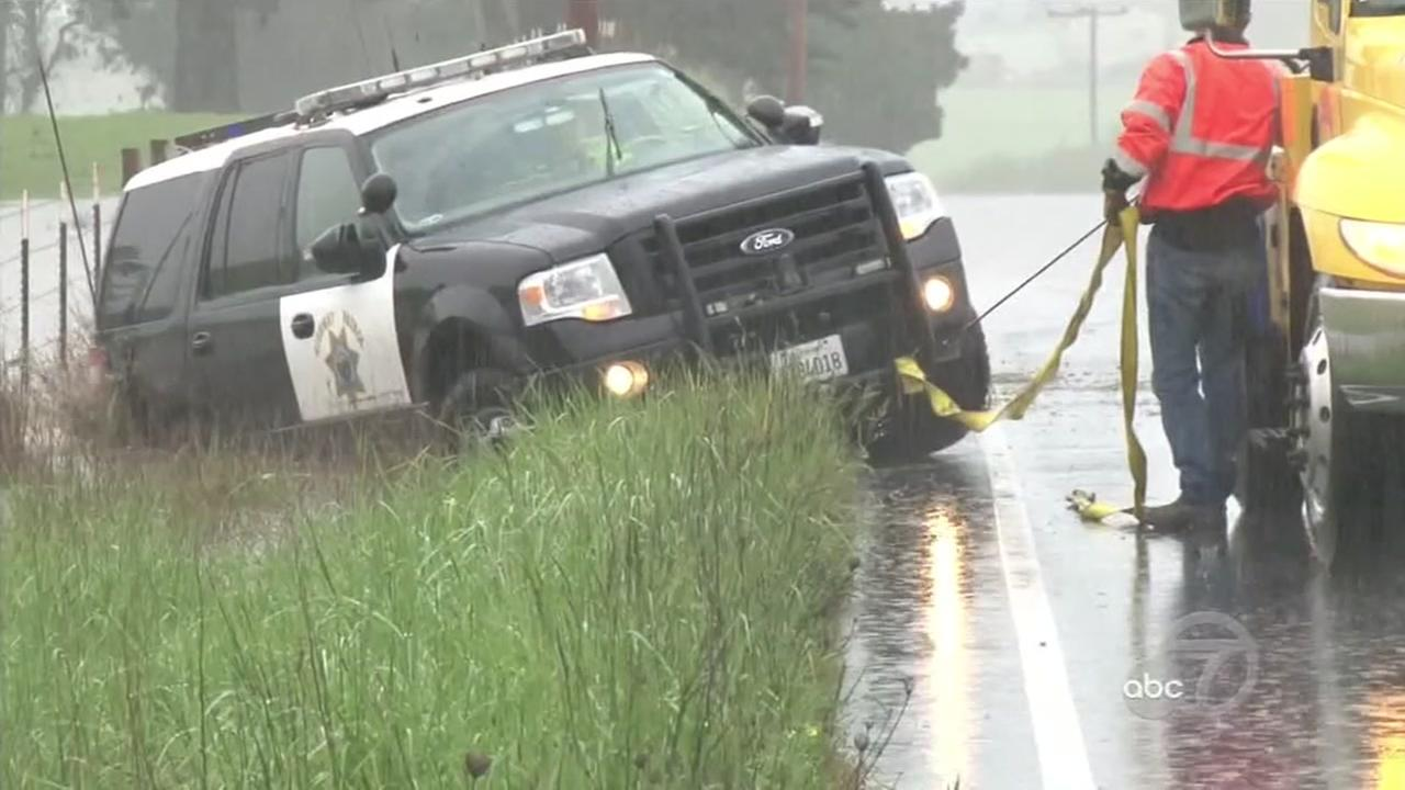 A struck police vehicle is towed off the side of the road in this photo taken in Sonoma County on Friday, April 6, 2018.