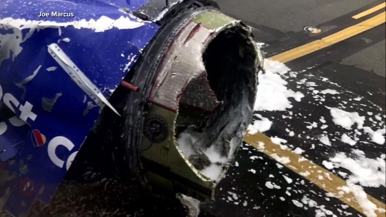 The engine of the Southwest 737 jetliner that snapped off the hub is seen on Tuesday, April 17, 2018.