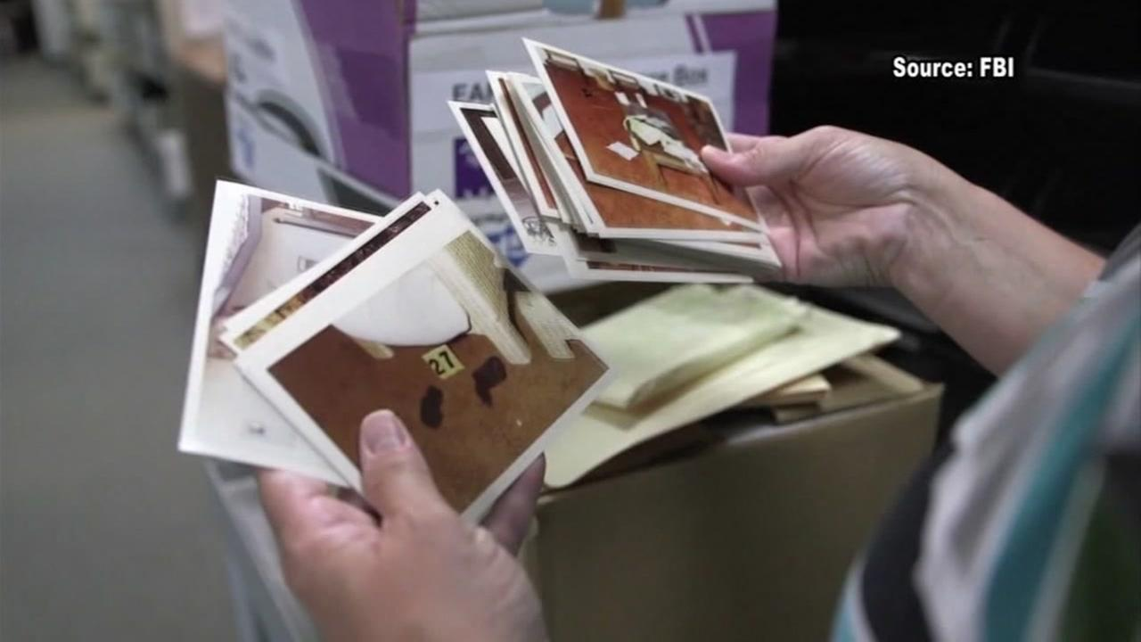 An investigator handles evidence from the Golden State Killer case in this undated image.