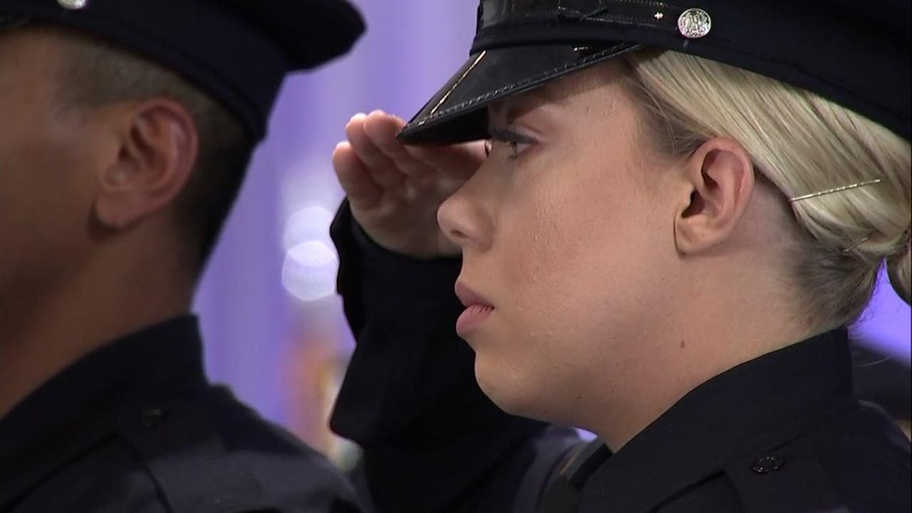 A San Jose, Calif. police officer salutes at her graduation ceremony on Friday, April 27, 2018.