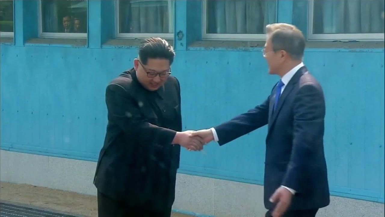 North and South Korean leaders shake hands at the DMZ during historic visit on April 27, 2018.