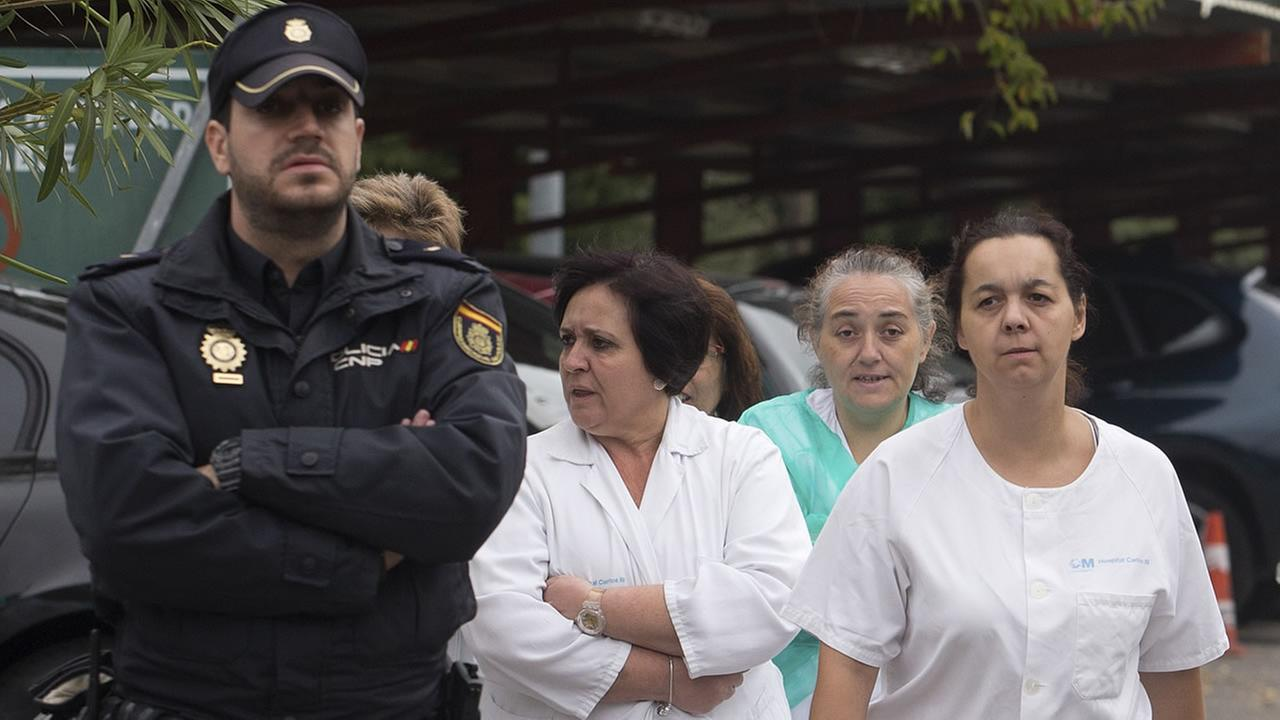 Hospital staff walk out to protest the Carlos III hospital in Madrid, Spain on  Tuesday.  A Spanish nurse is believed to have contracted the Ebola virus from a priest. (AP)