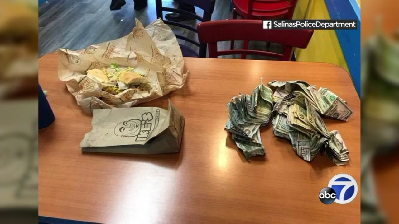 Cash is seen on the table at an Ikes shop in Salinas, Calif. on Tuesday, May 8, 2018.