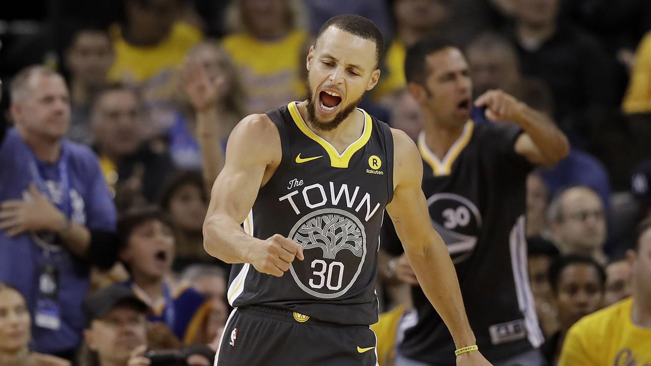 Warriors guard Stephen Curry (30) celebrates after scoring against the Houston Rockets during Game 4 of the Western Conference Finals in Oakland, Calif., Tuesday, May 22, 2018.