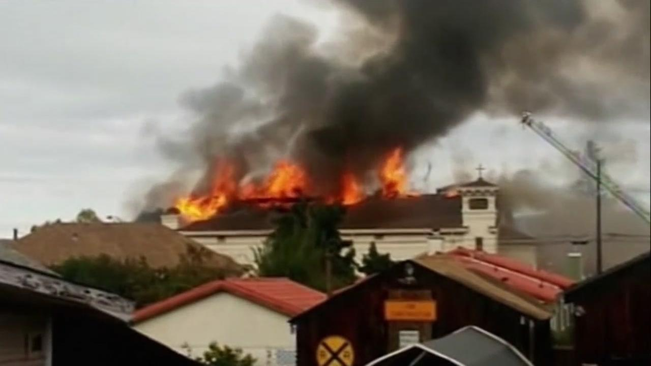 Holy Cross Church in San Jose, Calif. appears on fire in 2014.