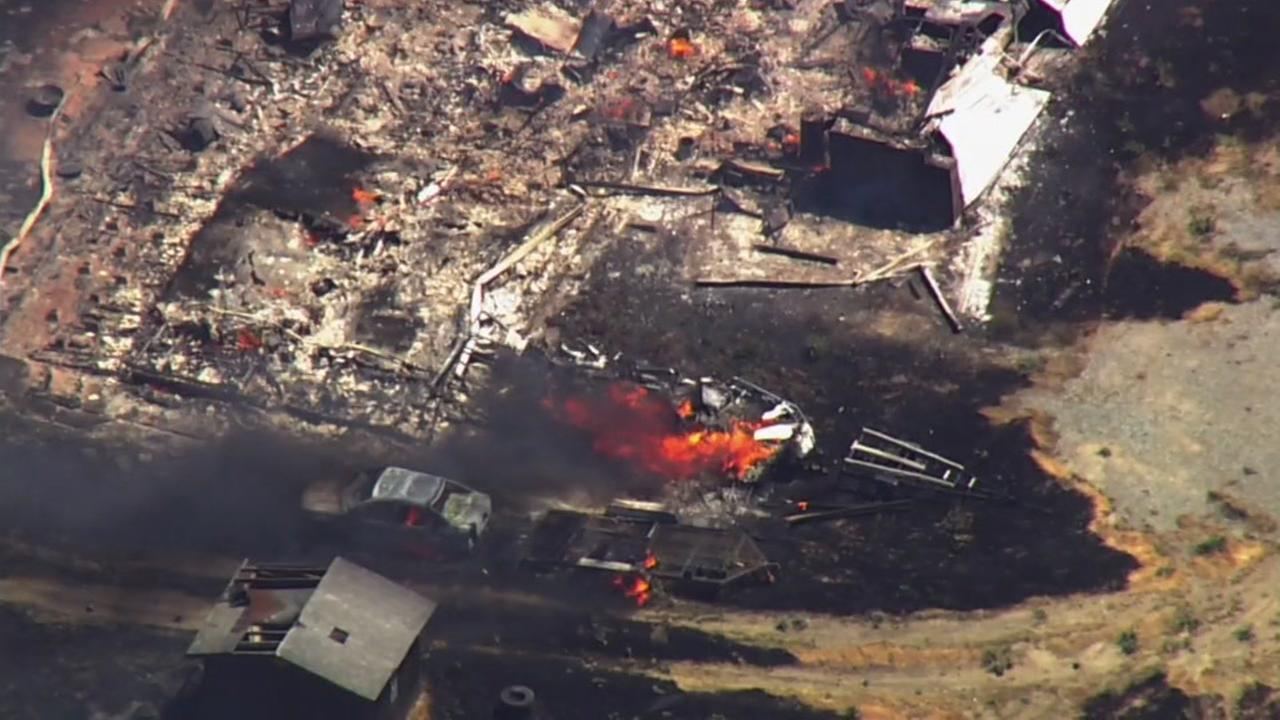 SKY7 was over the area as a brush fire destroyed a structure in Byron, Calif. on Wednesday, May 30, 2018.