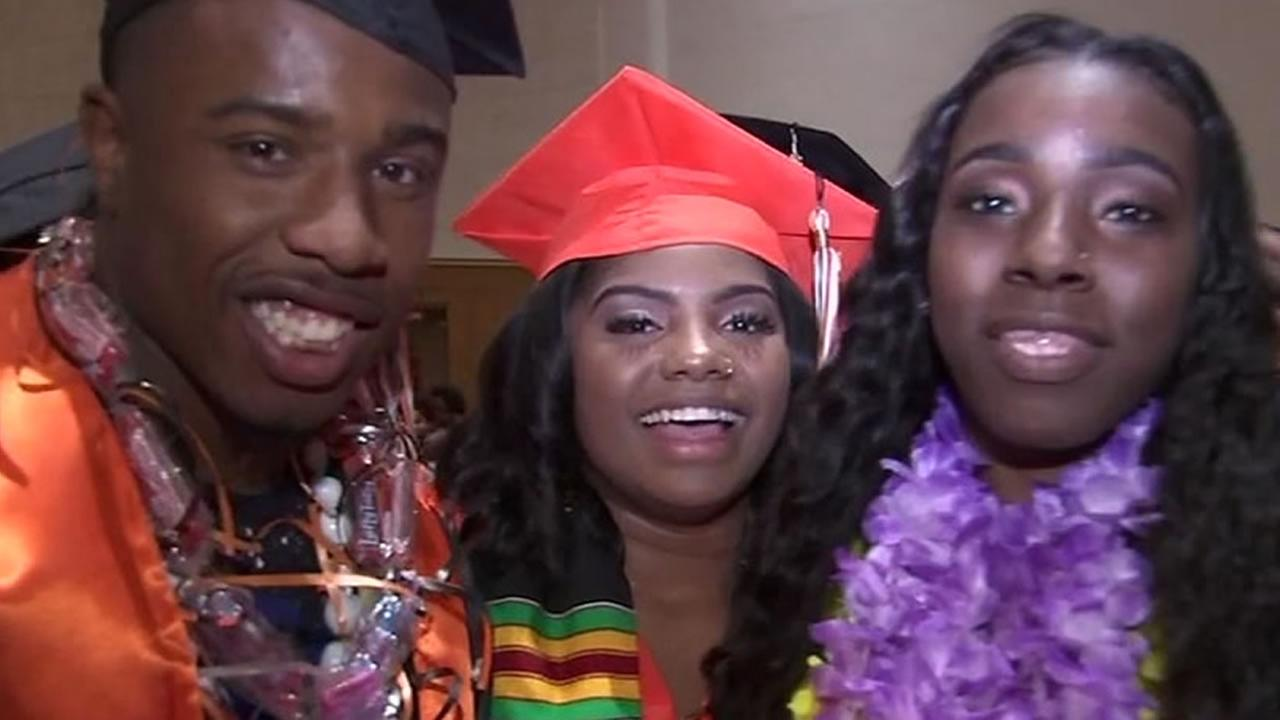 McClymonds High School graduates smile during their ceremony on Thursday, June 7, 2018 in Oakland, Calif.