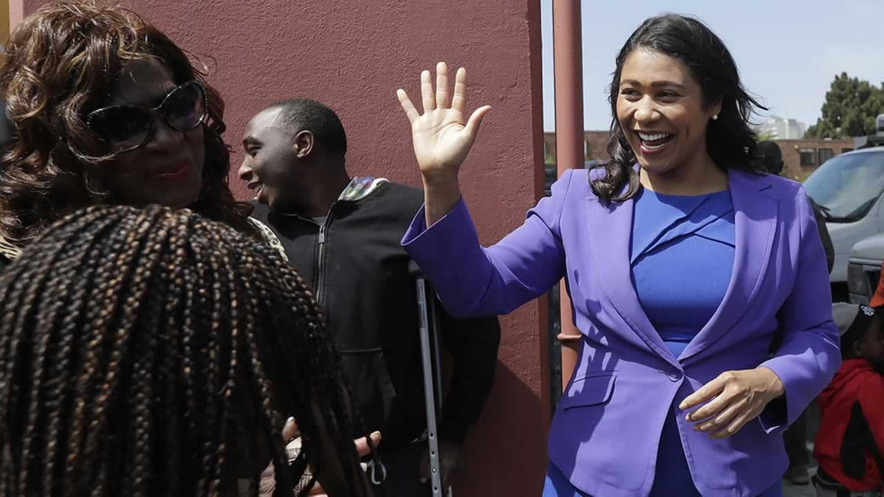Board of Supervisors President London Breed, right, greets supporters after speaking to reporters in San Francisco, Wednesday, June 6, 2018.