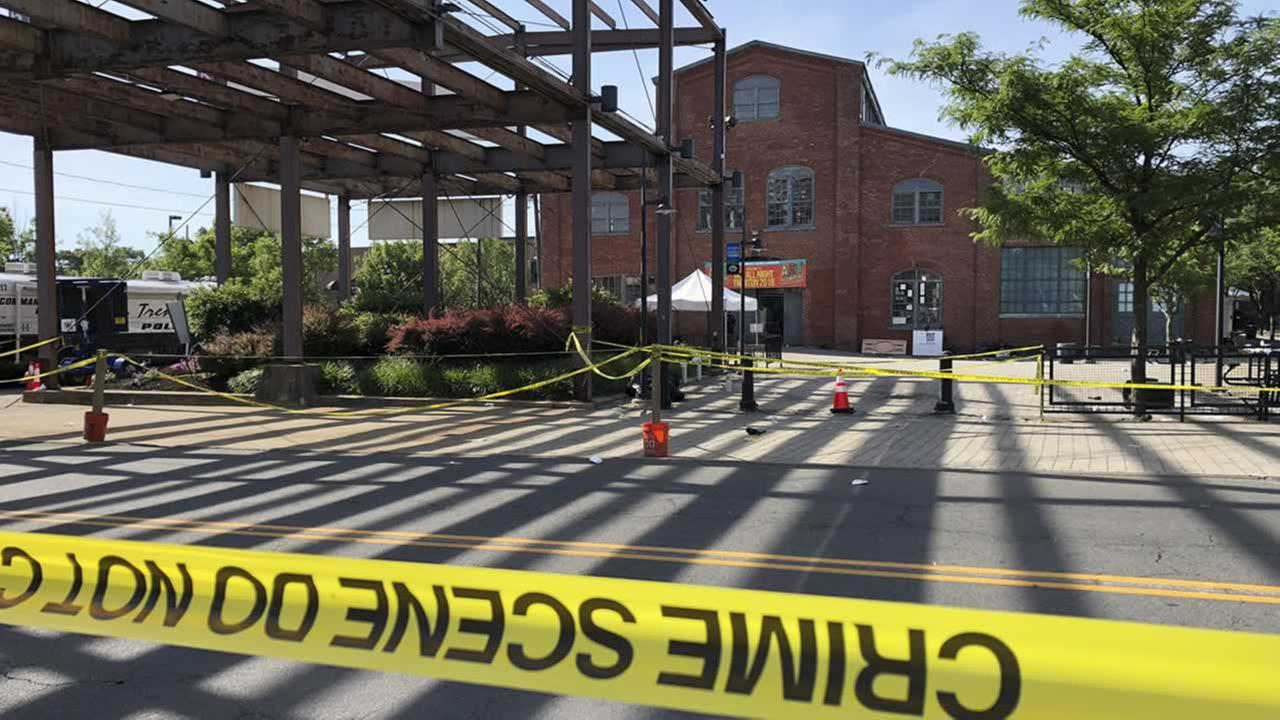 Police crime-scene tape keeps people away from the Roebling Wire Works building in Trenton, N.J., hours after a shooting broke out there early Sunday, June 17, 2018.