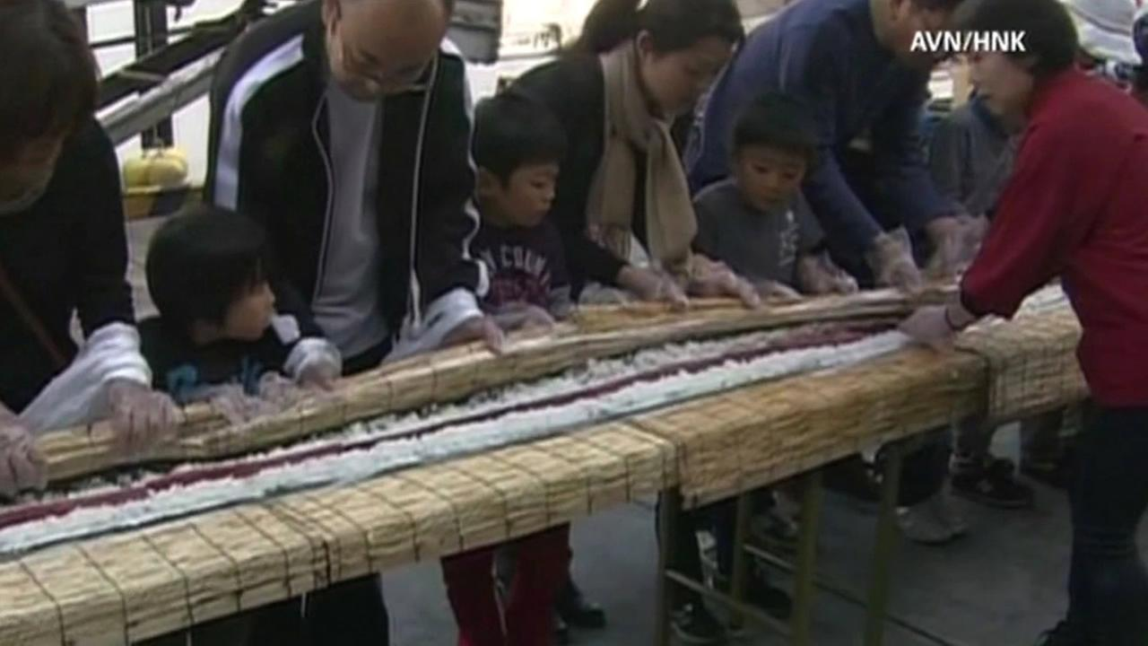 Nearly 1,300 people in Japan helped create the countrys largest tuna roll during an event at a local fish market on Sunday.