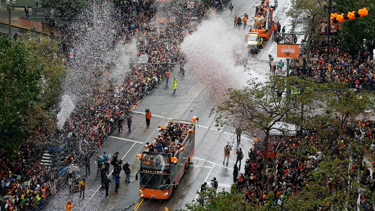 San Francisco Giants players ride in double decker buses during the victory parade for baseballs 2014 World Series Champion San Francisco Giants on Friday, Oct. 31, 2014.