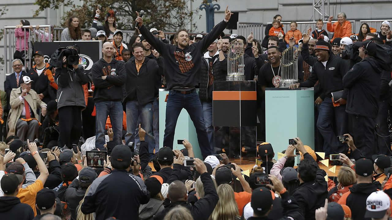 SF Giants Hunter Pence cheers with teammates and fans during a 2014 World Series baseball victory celebration in San Francisco, Friday, Oct. 31, 2014. (AP Photo/Jeff Chiu)