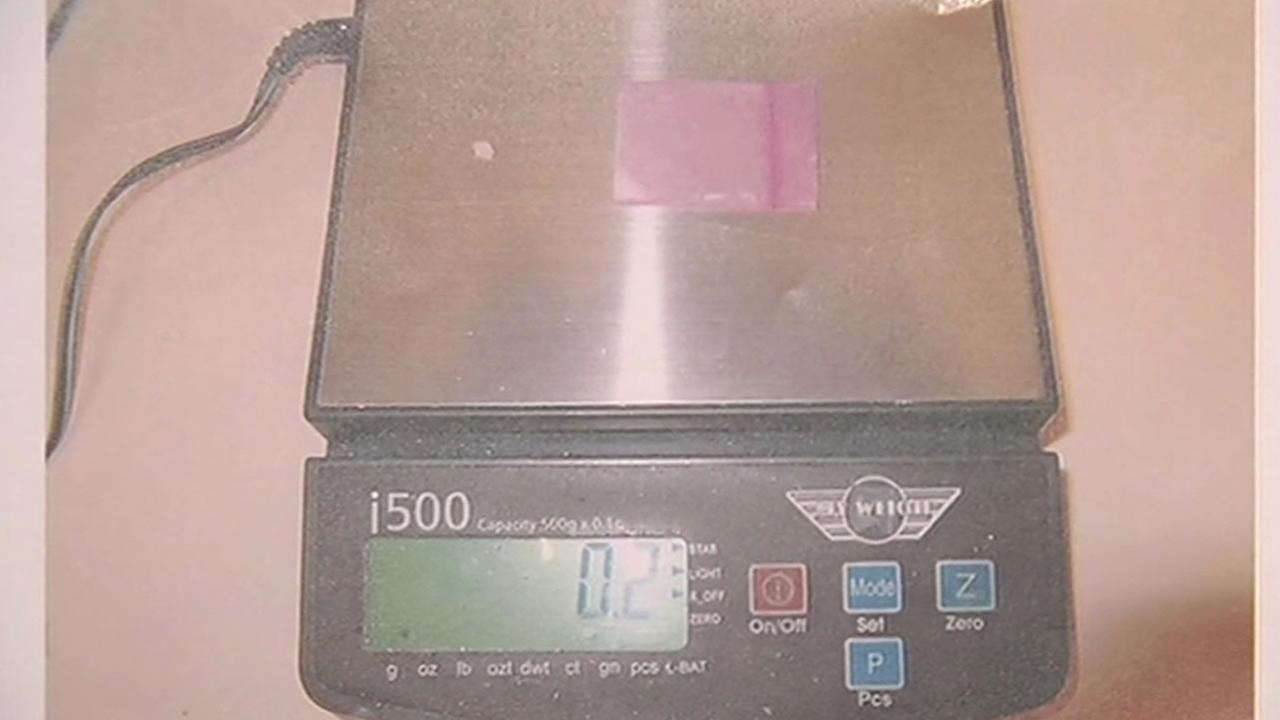 pink bag that contained meth being weighed on a scale