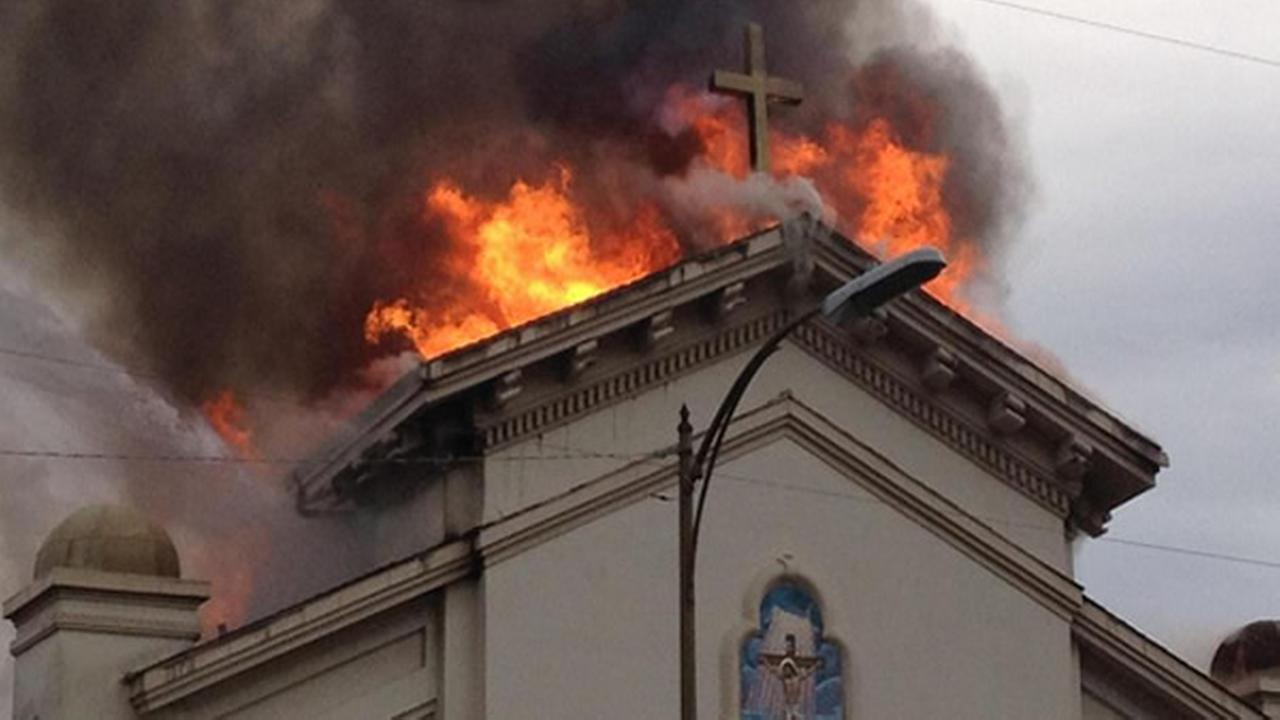 Crews battle a 4-alarm fire at the Holy Cross Parish church in San Jose on Sunday, November 16, 2014. (Courtesy: Manuel Salazar)