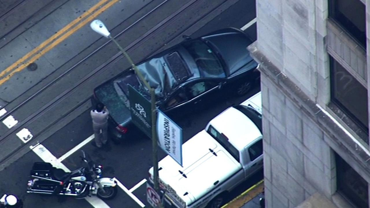 A window washer fell from a San Francisco building onto a car below on Friday.