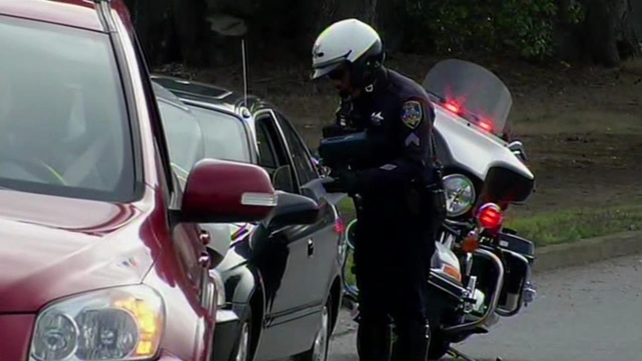 Police giving driver a ticket on Lake Merced Boulevard in Daly City