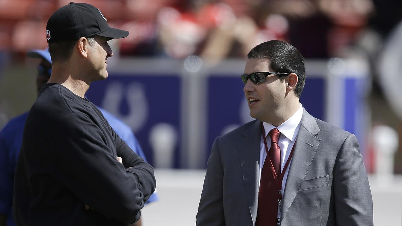 49ers head coach Jim Harbaugh, talks with owner Jed York before an NFL football game against the Colts in San Francisco, Sunday, Sept. 22, 2013. (AP Photo/Jeff Chiu)