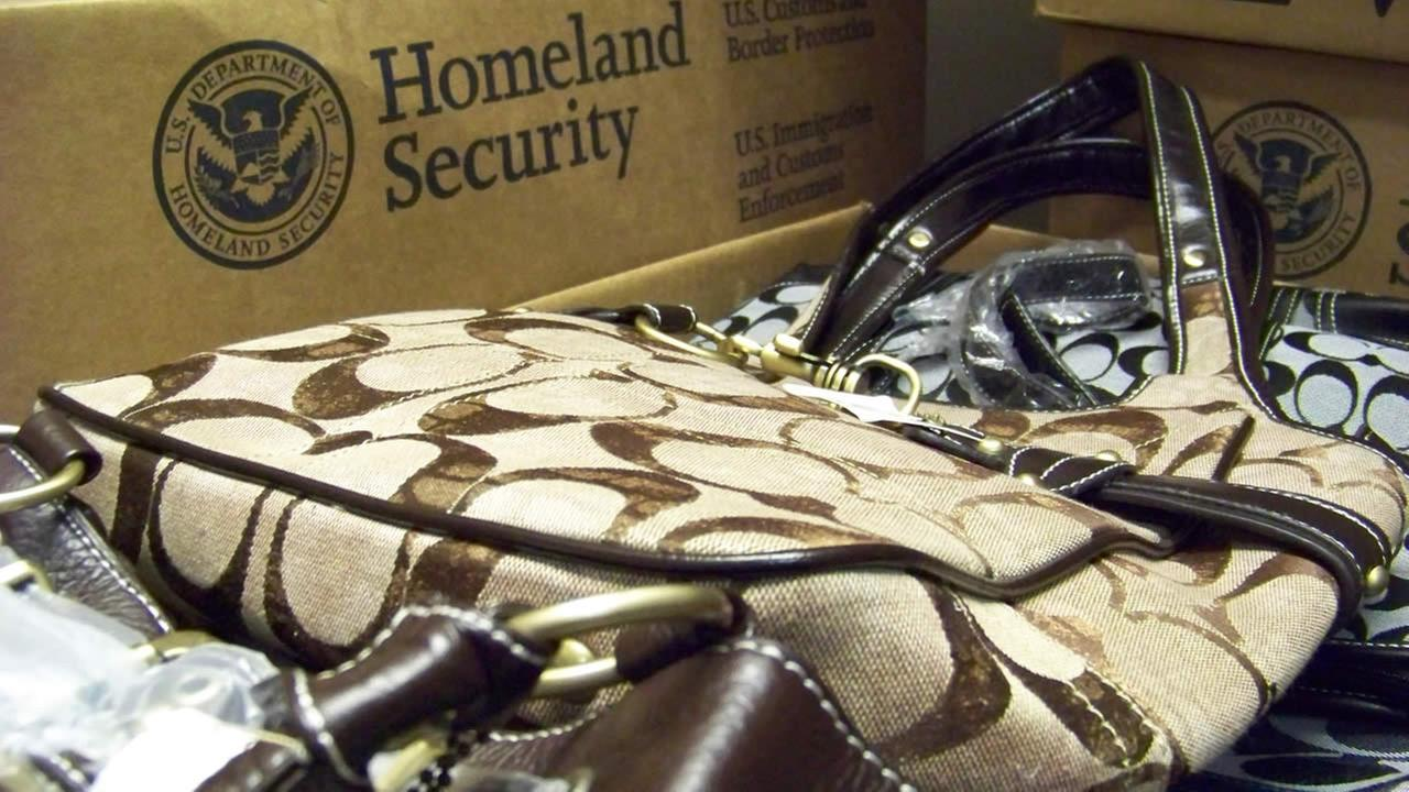 U.S. Immigration and Customs Enforcement officials on Wednesday, Nov. 25, 2009 display some of the 17,000 counterfeit items seized from Twin Cities-area businesses. (AP Photo)