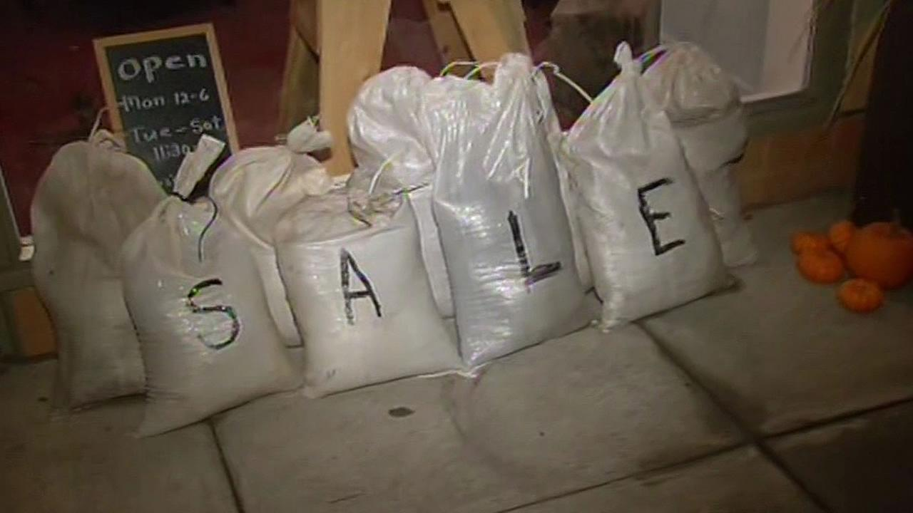 Sandbags with the word sale written on them