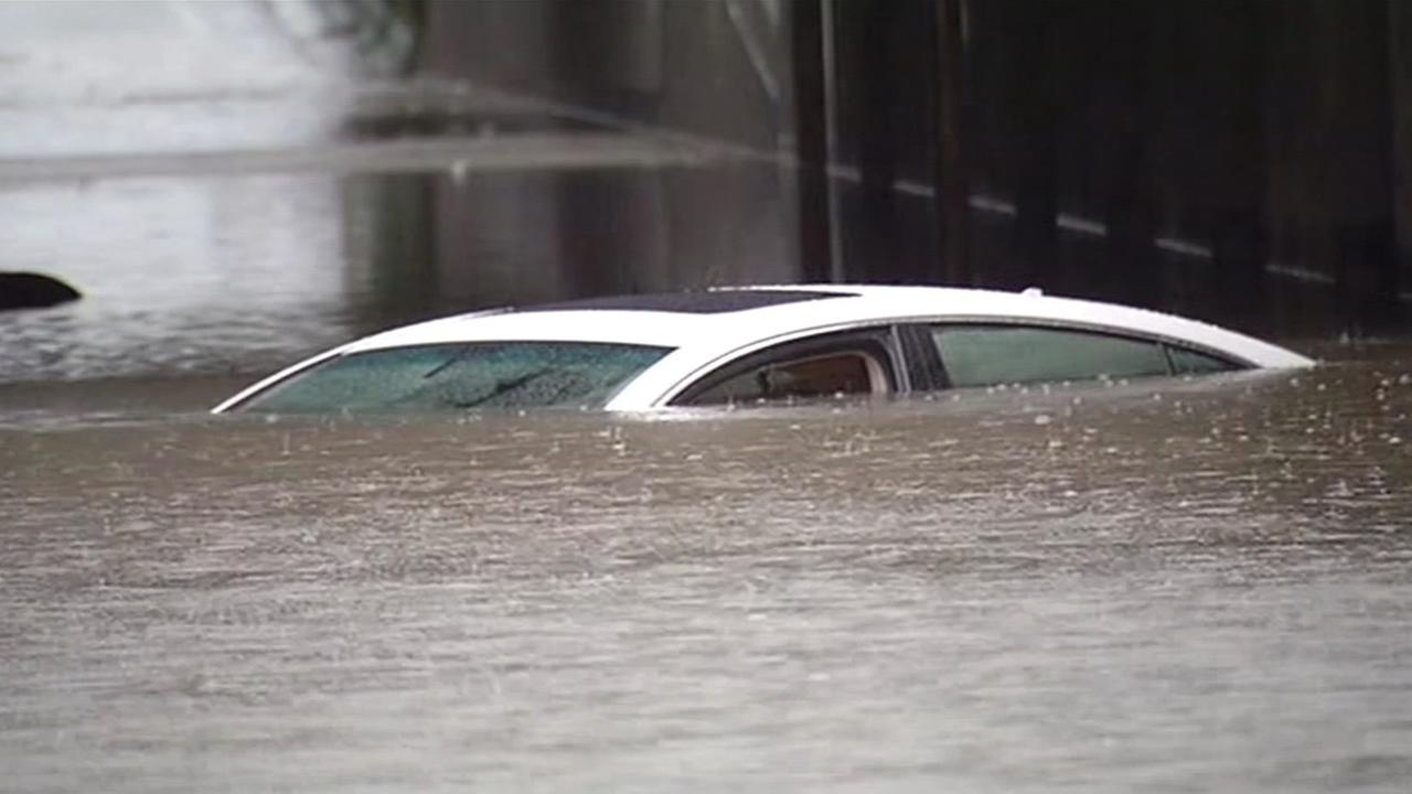 Car gets stuck in flooded underpass on Ashby Avenue in Berkeley