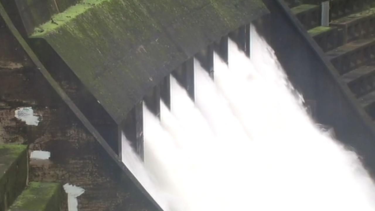 Alpine Dam gushes with fast moving water