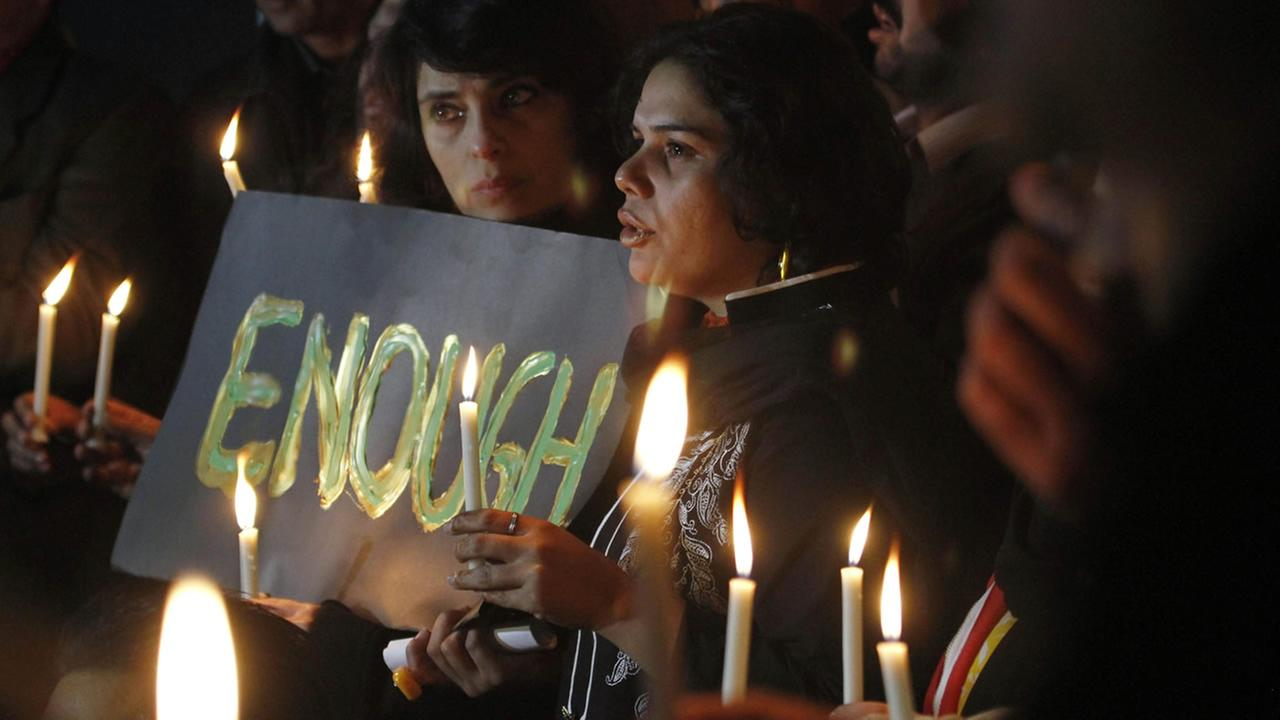 Pakistani civil society members take part in a candle light vigil for the victims of a school attacked by the Taliban in Peshawar, Dec. 16, 2014 in Islamabad, Pakistan .(AP Photo)