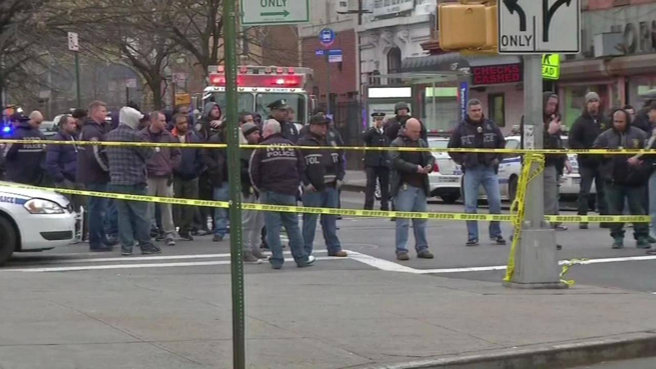 Two NYC police officers were ambushed while sitting in their police cruiser Saturday.